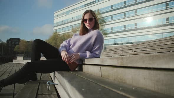 Thumbnail for Brunette Woman In Sunglasses And Jumper