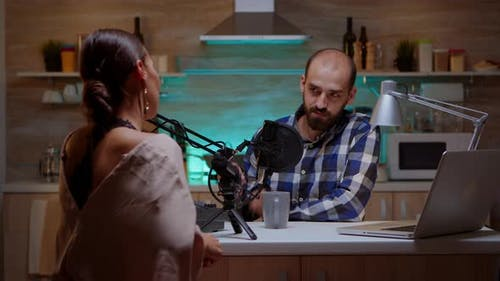 Man Interviewing Woman Vlogger