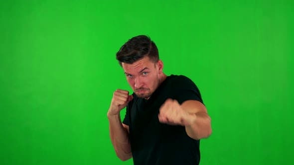 Thumbnail for Young Handsome Caucasian Man Does Box - Green Screen - Studio
