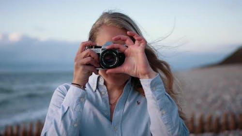 Photographer Focusing Slr To Camera