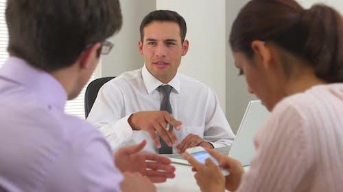 Hispanic businessman closing the deal