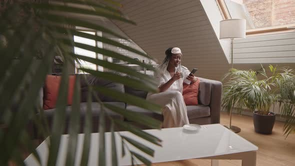 African American Woman Drinking Coffee in Morning