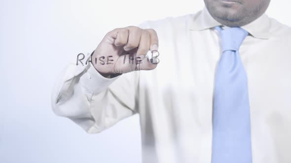 Asian Businessman Writes Raise The Bar