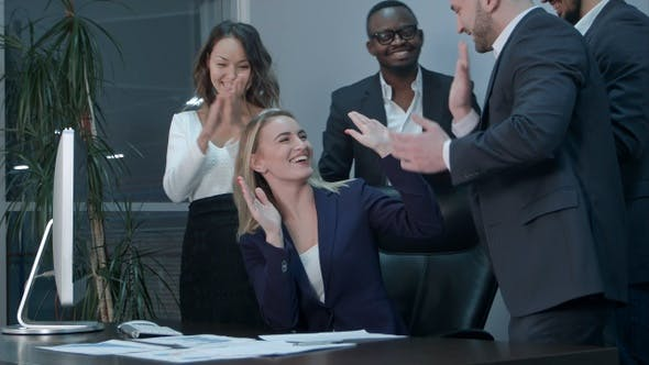 Cover Image for Business team applauding during meeting in the office