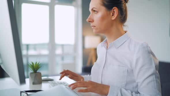 Thumbnail for Woman Is Typing on a Computer Keyboard. Concept of Remote Work