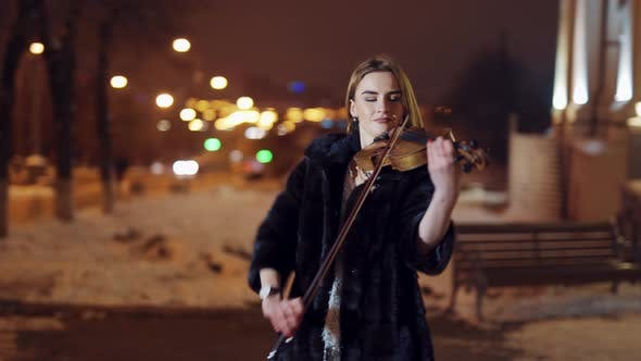 Thumbnail for Playing Violin Instrument in the Winter Time