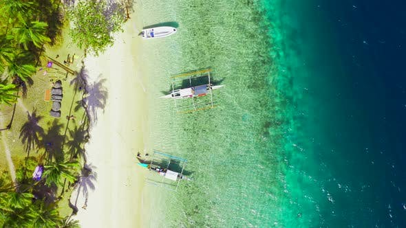 Cover Image for Boats Moored at Paradise Tropical Ipil Beach on Pinagbuyutan Island with Azure Turquoise Sea in El