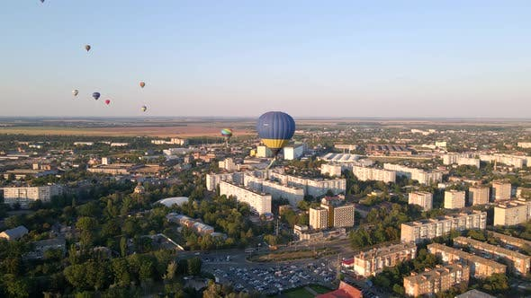 Thumbnail for Aerial Drone View of Colorful Hot Air Balloons Flying Over Green Park and Industrial District in
