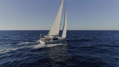 Sailboat Butting Through the Waves in the Mediterranean Waters