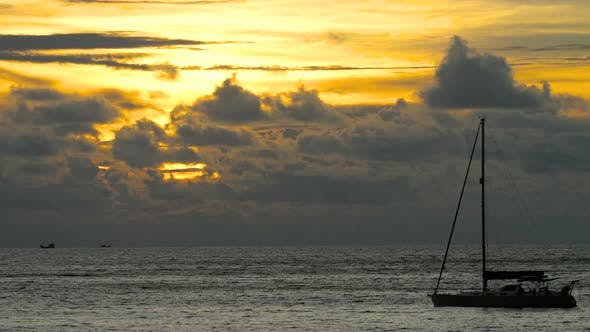Thumbnail for Yacht in the Tropical Sea at Dramatic Sunset