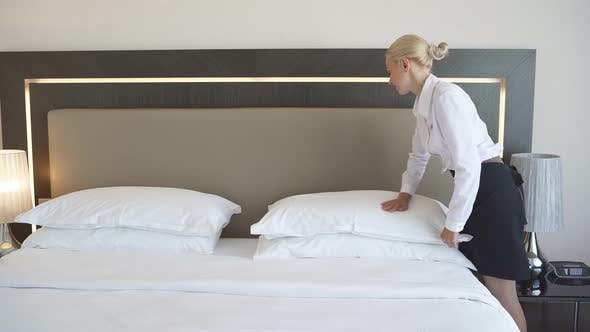 Nice Maid Prepares a Bed for Guests