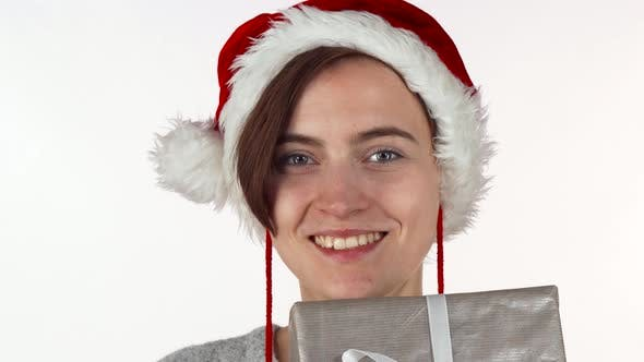 Thumbnail for Attractive Christmas Woman Hiding Her Face Behind a Present Box