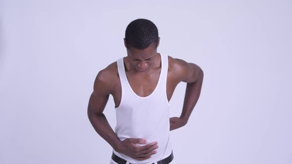 Thumbnail for Young Stressed African Man Having Stomach Ache