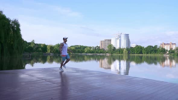 Cover Image for Healthy Young Athlete Training with Jump Rope Near City Lake