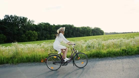 Thumbnail for Woman Riding Bicycle in Countryside