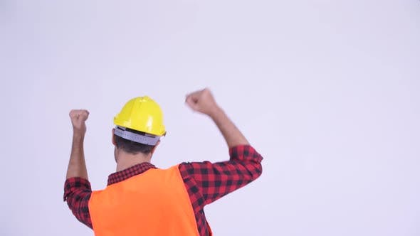 Thumbnail for Rear View of Happy Bearded Persian Man Construction Worker with Fists Raised