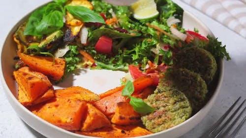 Falafel salad bowl. Vegan lunch plate.