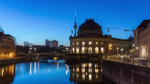 Sunrise hyperlaps of central Berlin skyline in 4k with TV Tower and spree river