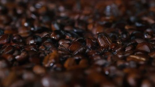 Close-up, Dark Coffee Beans Are Roasted. Freshly Roasted Aromatic Coffee, Coffee Grains.