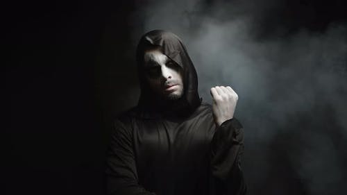 Man Dressed Up Like Grim Reaper for Halloween Party