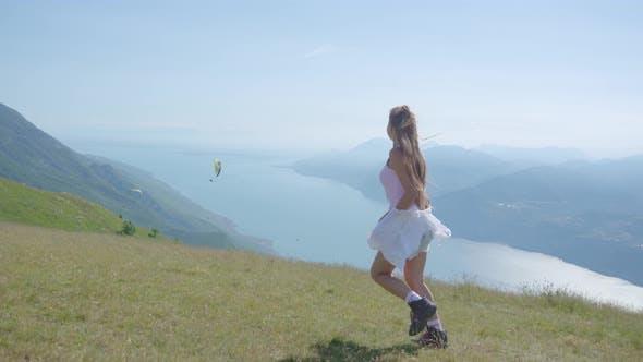 Young Girl Runs Over the Mountains at Lake Garda