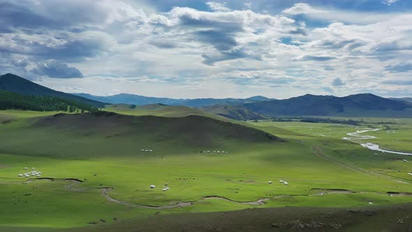 Thumbnail for Aerial View of Yurts in Steppe and Mountains