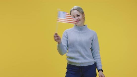 Woman Waving British Flag