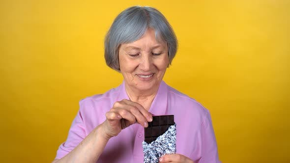 Cover Image for Portrait of Elderly Woman Eating Chocolate