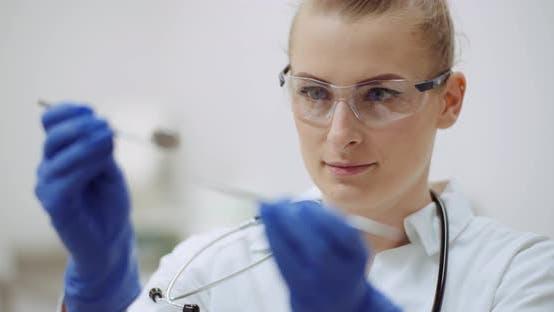 Thumbnail for Female Dentist Checking Dental Instruments at Dental Clinic