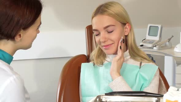 Thumbnail for Beautiful Woman Visiting Dentist with Aching Tooth