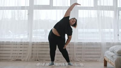 A Fat Woman Doing Exercises at Home