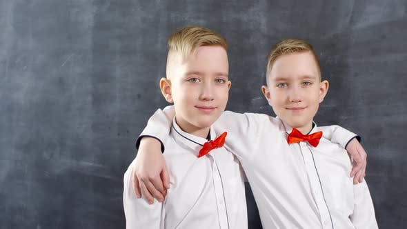 Cover Image for Caucasian Twin Brothers Posing for School Yearbook