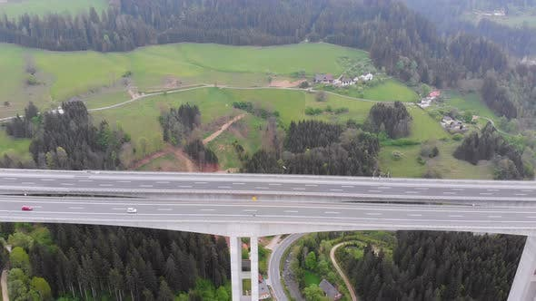 Thumbnail for Aerial View of the Highway Viaduct on Concrete Pillars with Traffic in Mountains