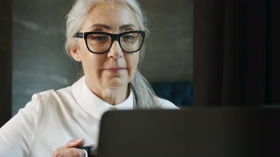 Thumbnail for Elderly Woman with Laptop and Coffee