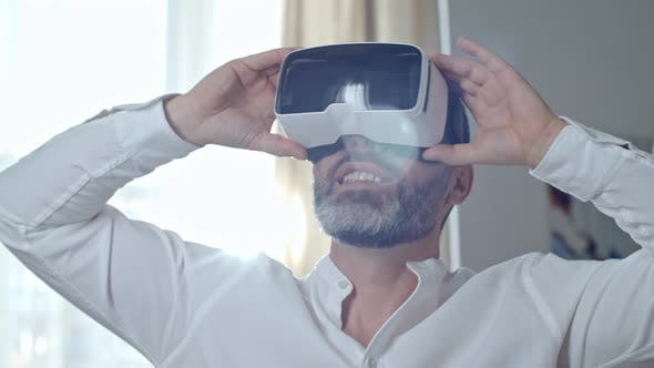 Thumbnail for Excited Middle-Aged Man in VR Headset