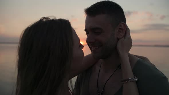 Thumbnail for Happy Couple Kissing at Sunset