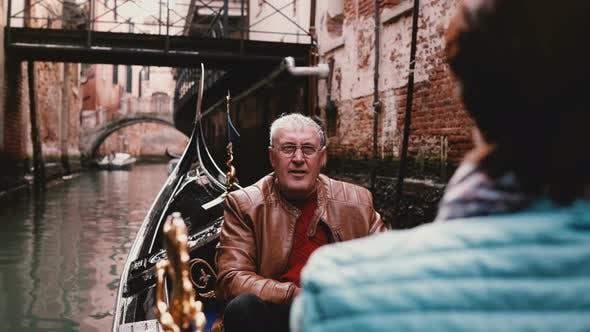 Thumbnail for Happy Smiling Senior European Man and Woman in Gondola Enjoying Venice Canal Tour Excursion on