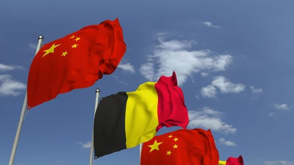 Flags of Belgium and China Against Blue Sky