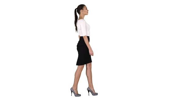 Thumbnail for Young business woman is walking on white background.