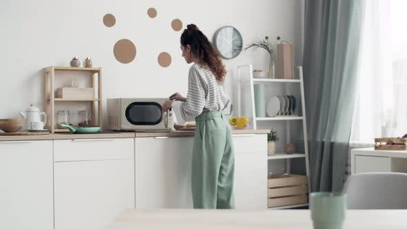 Woman Cooking and Answering Video Call