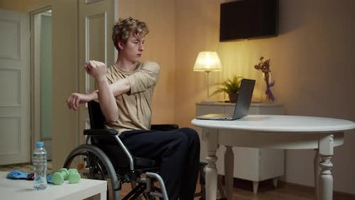 A Disabled Man is Spreading His Arm in Different Sides