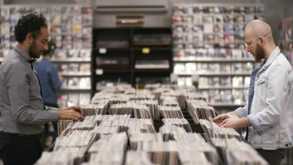 Thumbnail for Multiethnic Customers Hanging out in Record Shop
