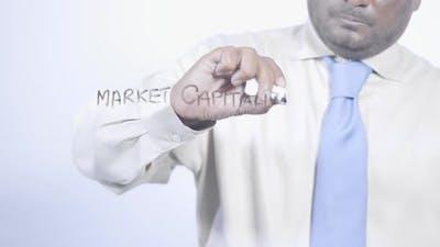 Asian Businessman Writes Market Capitalization