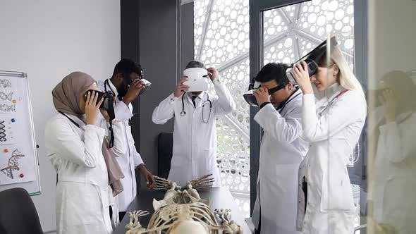 Male and Female Doctors Wearing Virtual Reality Headset to Learn the Structure of Human Skeleton