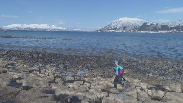 Thumbnail for Girl is Running Along The Nordic Beach
