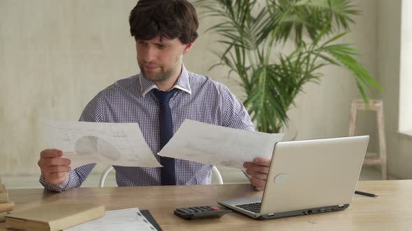 Frustrated Business Man Throwing Documents Away at Workplace