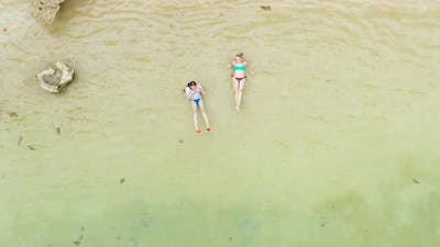 Tourists Relax on a Sandy Beach Top View