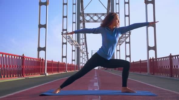 Cover Image for Girl Doing Yoga at Sunrise