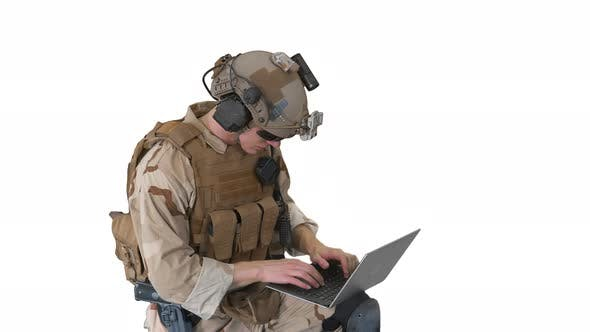Soldier Using Laptop Computer for Surveillance During Military Operation on White Background