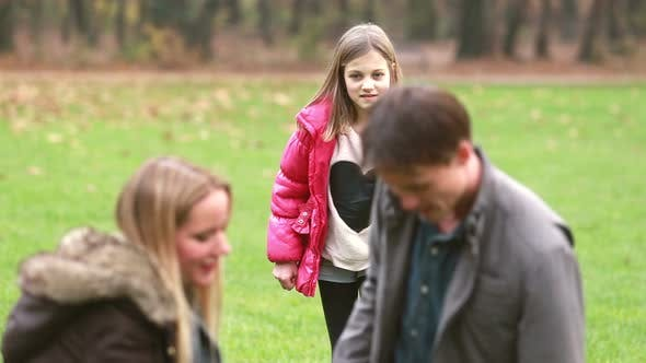 Thumbnail for Girl sneaking up to her parents and surprising them